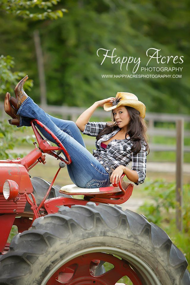 Posing naked on tractors pics