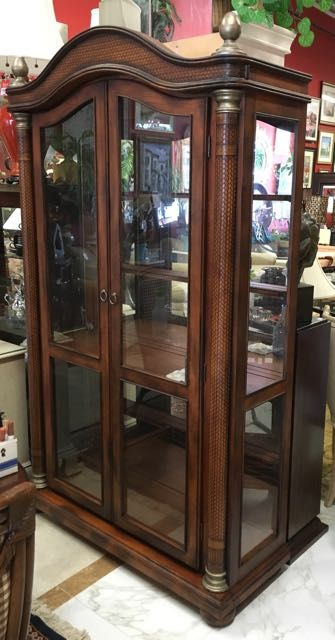 Tommy Bahama Style China Cabinet Has Plaited Leather Columns