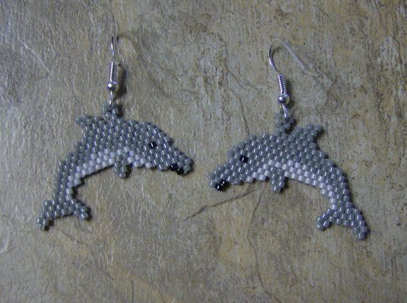 These cute little dolphin earrings are done in the brick stitch with size 11 delica glass beads. The colors that I have used are black, dark grey, and pale grey. They are a 1/2 inch long. The designer is Alan Grey Owl. I do all of my own bead work one bead at a time. Thank you for looking at