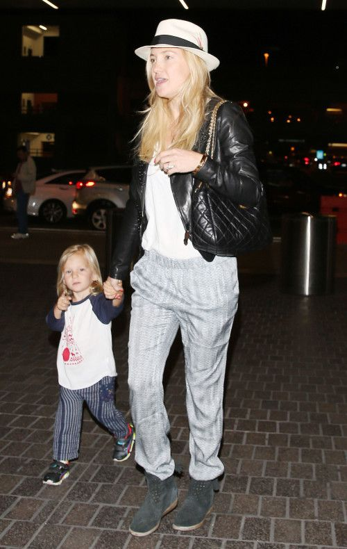 Kate Hudson departs a flight at LAX Airport with her son Bingham on May 11, 2014