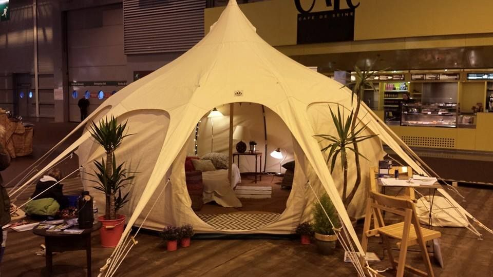 A novel idea for pitching the tent on concrete create a wooden base and anchor down. This image was from a trade show in France & A novel idea for pitching the tent on concrete create a wooden base ...