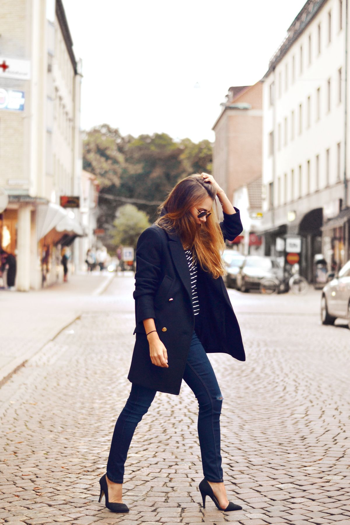 Lots of love for nautical style: a striped shirt plus a navy pea coat. Photo by Evelina Svantesson