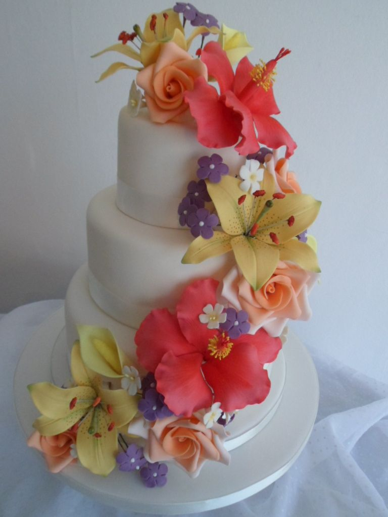 Wedding Cake With Sugar Paste Flowers Including Lilies Hibiscus