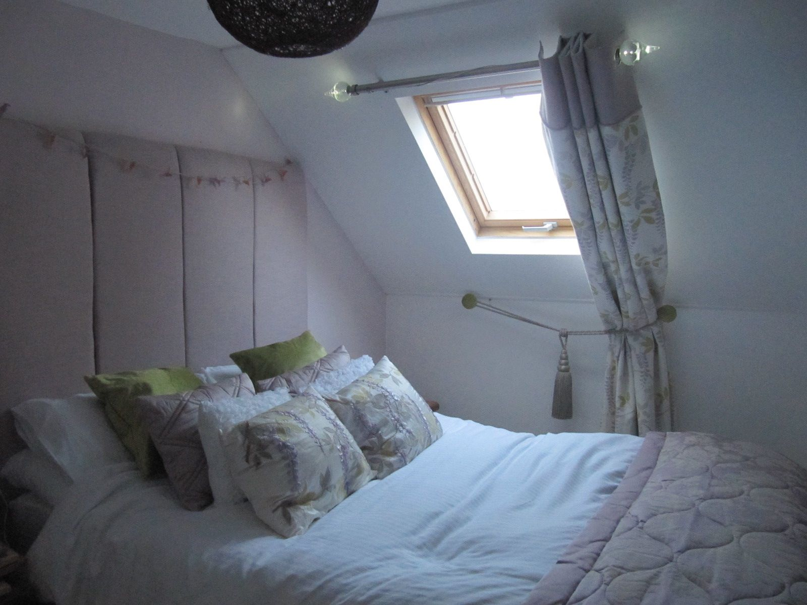 Small Loft Space Converted Into Welcoming Bedroom