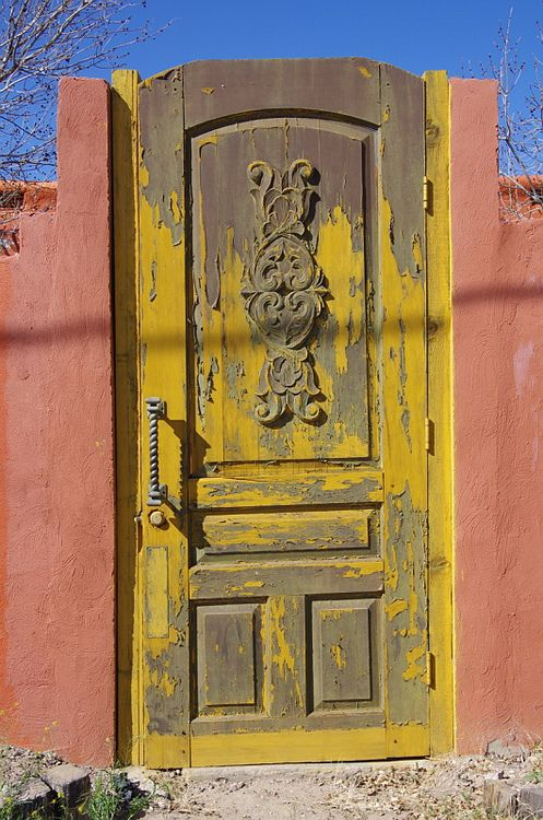 Yellow weathered door in La réunion-New Mexico