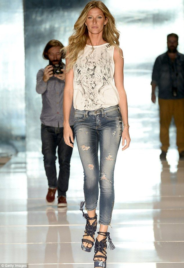 202b6b38b Casual chic: Gisele donned a white top, blue jeans, and the same pair of  tie-up grey platform sandals that she wore during the actual show