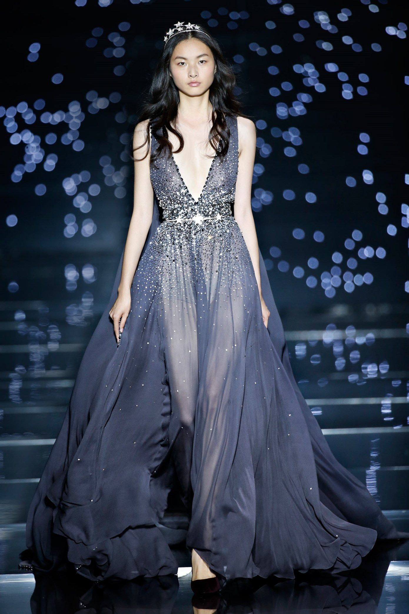 """Couture Fall Winter 2015-16 - Long fluid dress with plunging neckline and gray georgette crepe """"pans dans le dos"""" enhanced with tone on tone stone constellations."""