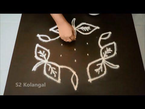 Simple Flower Kolam With 7 To 4 Interlaced Dots Youtube Arouna