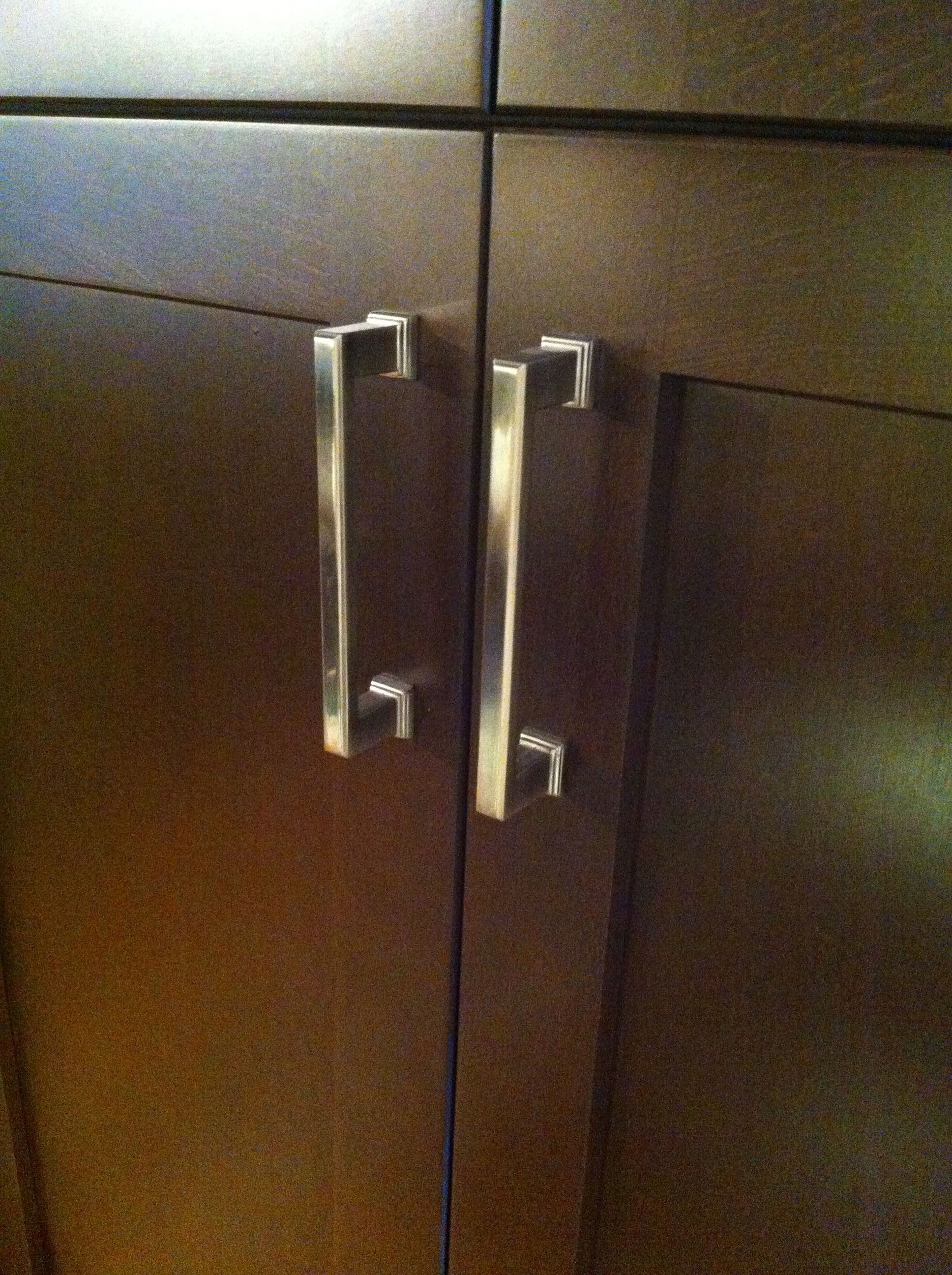 Alexander emtek pull shown on wood cabinet this photo shows the narrow detail of the pull shown in satin nickel