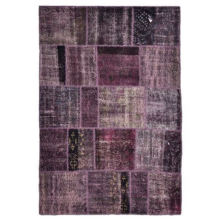 Wool and cotton rug with a purple patchwork motif.  Product: RugConstruction Material: Wool and cotton