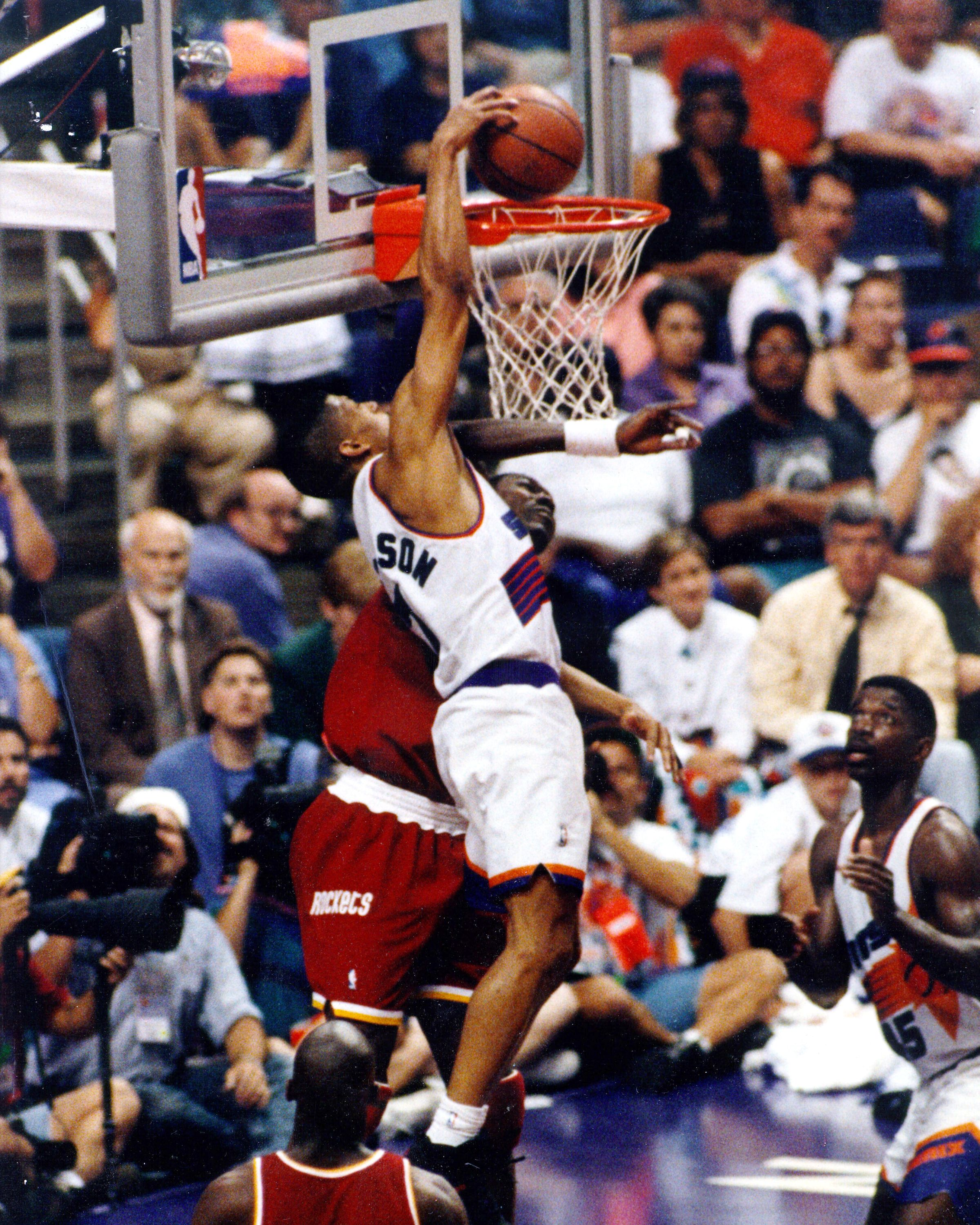 Kevin Johnson dunks Hakeem Olajuwon