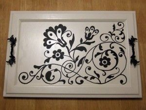 Transform an old cabinet door into a serving tray.