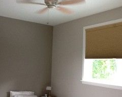 Two shades of gray right next to each other on Sherwin Williams color wheel are Modern Grey and Taupe Tone.