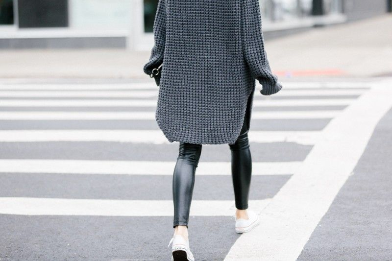 Leggings with an oversized sweater and sneakers.