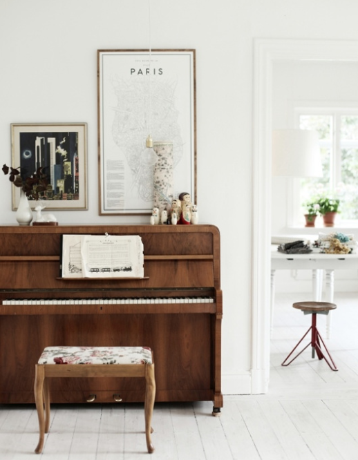 piano styling. Love the little gallery above and upholstered bench