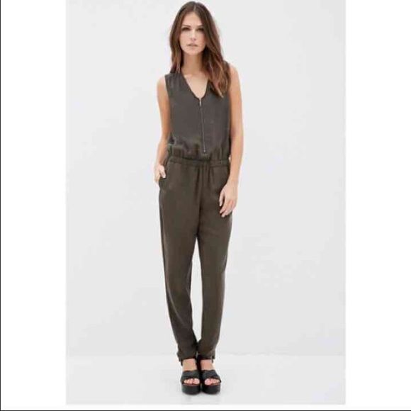 Olive green jumpsuit I'm 5'2 and it's a tiny bit long on me. I've worn it twice recently with a sweater over it and gotten many compliments. No trades Forever 21 Pants Jumpsuits & Rompers
