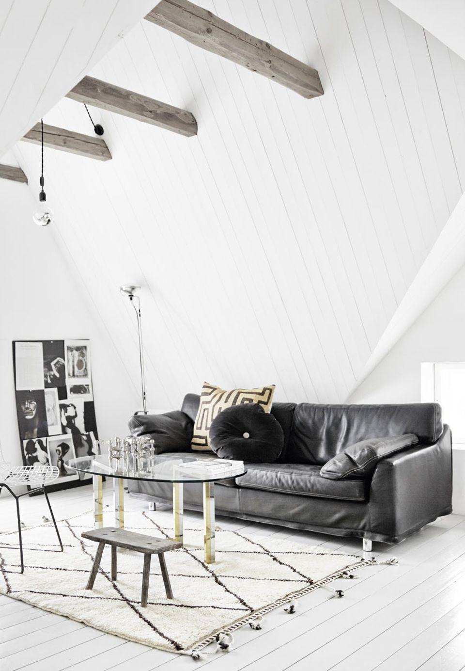 wooden ebams, pattern rug, white floor, nordic decor, nagel candlesticks