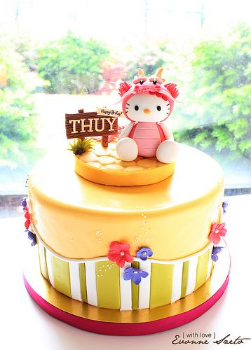 Dragon Hello Kitty Cake. I love the stripes on the bottom