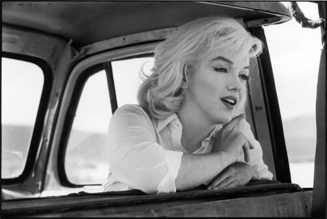 Are Women Bad Navigators?: American actress Marilyn Monroe leans over the back of the front seat of a car on the set of 'The Misfits,' (1960)