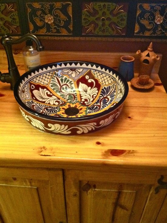 mexican painted sink in bathroom with wood counter top i would put this in a white bathroom and use it as inspiration to draw colours from