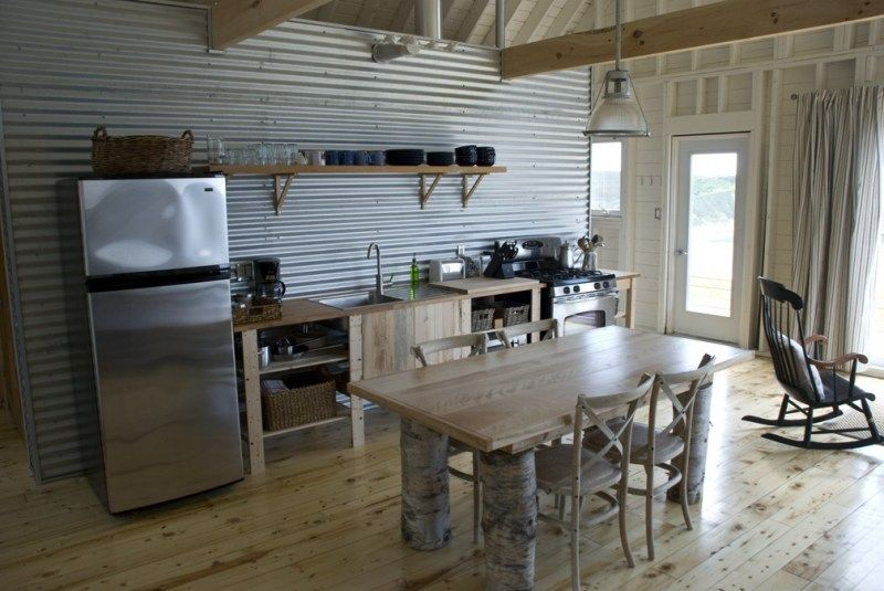 Corrugated Metal Wall And Exposed Framing Of Small Cottage On Cape Breton  Island