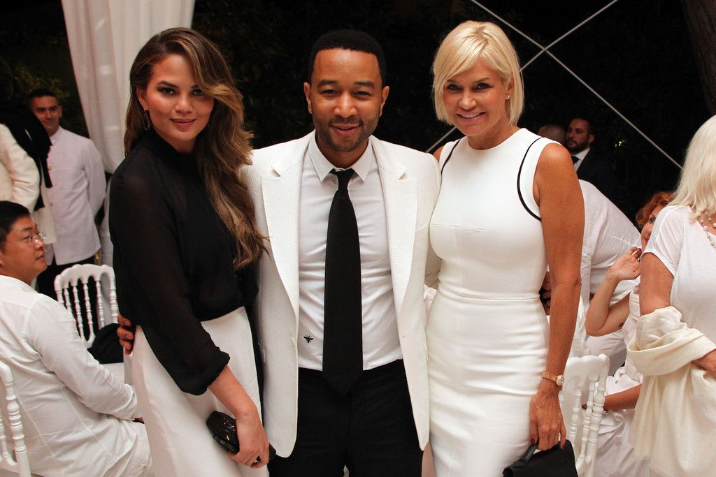 Chrissy Teigen, John Legend and Yolanda Foster attend the White Party Dinner Hosted by Andrea and Veronica Bocelli Celebrating Celebrity Fight Night In Italy Benefitting The Andrea Bocelli Foundation and The Muhammad Ali Parkinson Center on September 5, 2014 at the Bocelli Residence in Forte dei Marme, Italy.