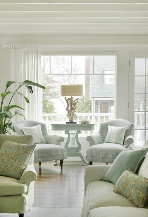 Light Blue Celery Green Bright Natural Lighting Almost Mute Out The Pale Blue Chairs And White Table The Home Living Room Coastal Living Rooms Home And Living