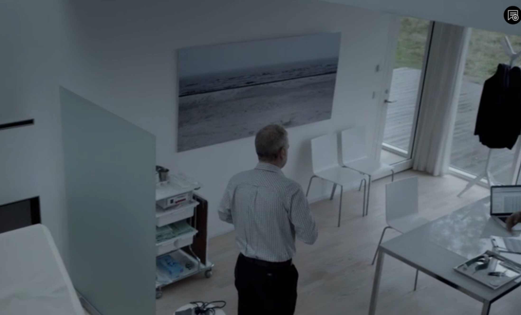 Screenshot from Wallander on PBS Masterpiece Mystery.  Interior of doctor's office.  Frosted glass partition, floor to ceiling windows, contemporary furniture.  Contemporary Scandinavian design.