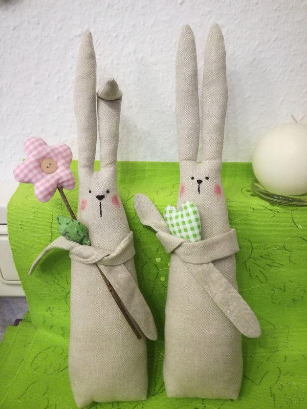 Photo of in liebevoller Handarbeit genähtes Häschen    der eine hält ein grün-weiß-k…