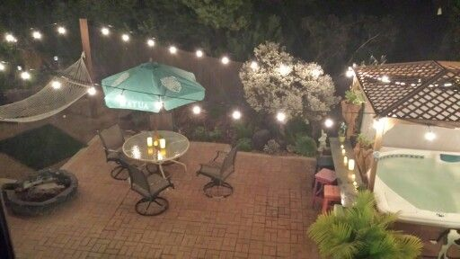 Back yard out door String lights in a brick patio