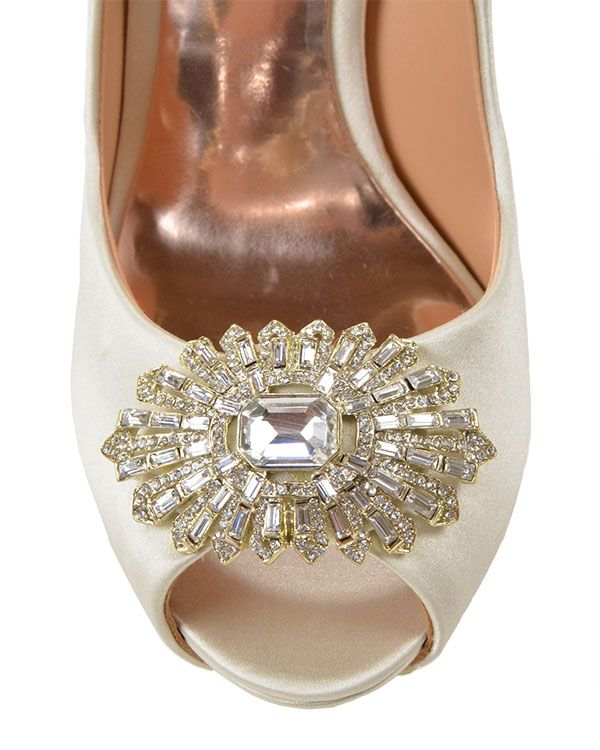 Finn Peep Toe Pump - Style # : FINN - IVORY - $245.00 - Finn by Badgley Mischka. This classic and elegant shoe is a must have! It is has the perfect high heel to give your legs the extra length and the decoration at the peep toe is simply jaw dropping. This classic shoe works for every occasion and every ensemble. Available in Ivory or Navy. - Heel height: 4 1/2 inches. 1 inch platform. - Sale price is only applicable to online purchases and not valid in Badgley Mischka stores. Items…