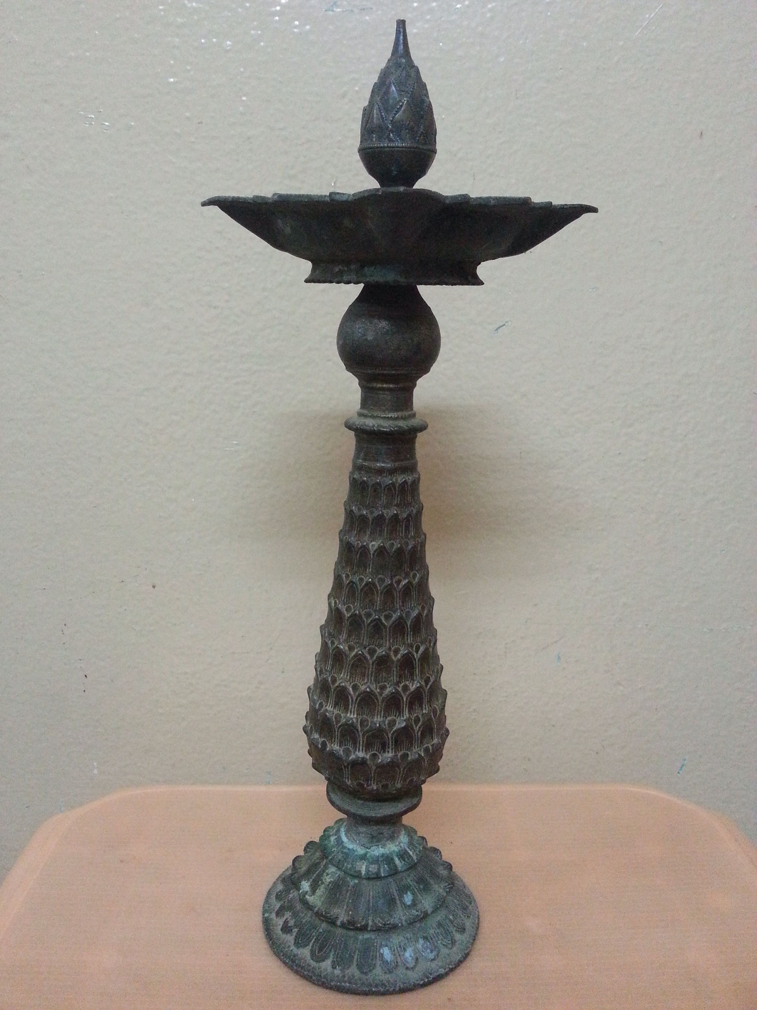 Pineapple lamp from the Deccan. The base and the oil basin