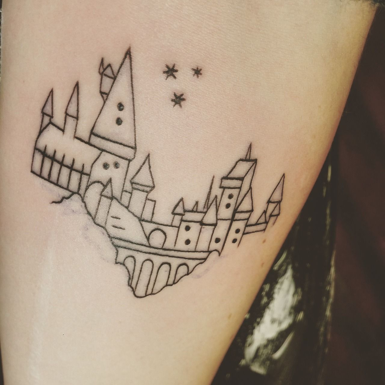 Ink Pedia Glad To Finally Welcome Tattoo 3 An Outline Of Hogwarts Castle Done By Aaron At Ohana Tattoo Parlor Hogwarts Tattoo Bookish Tattoos Ohana Tattoo