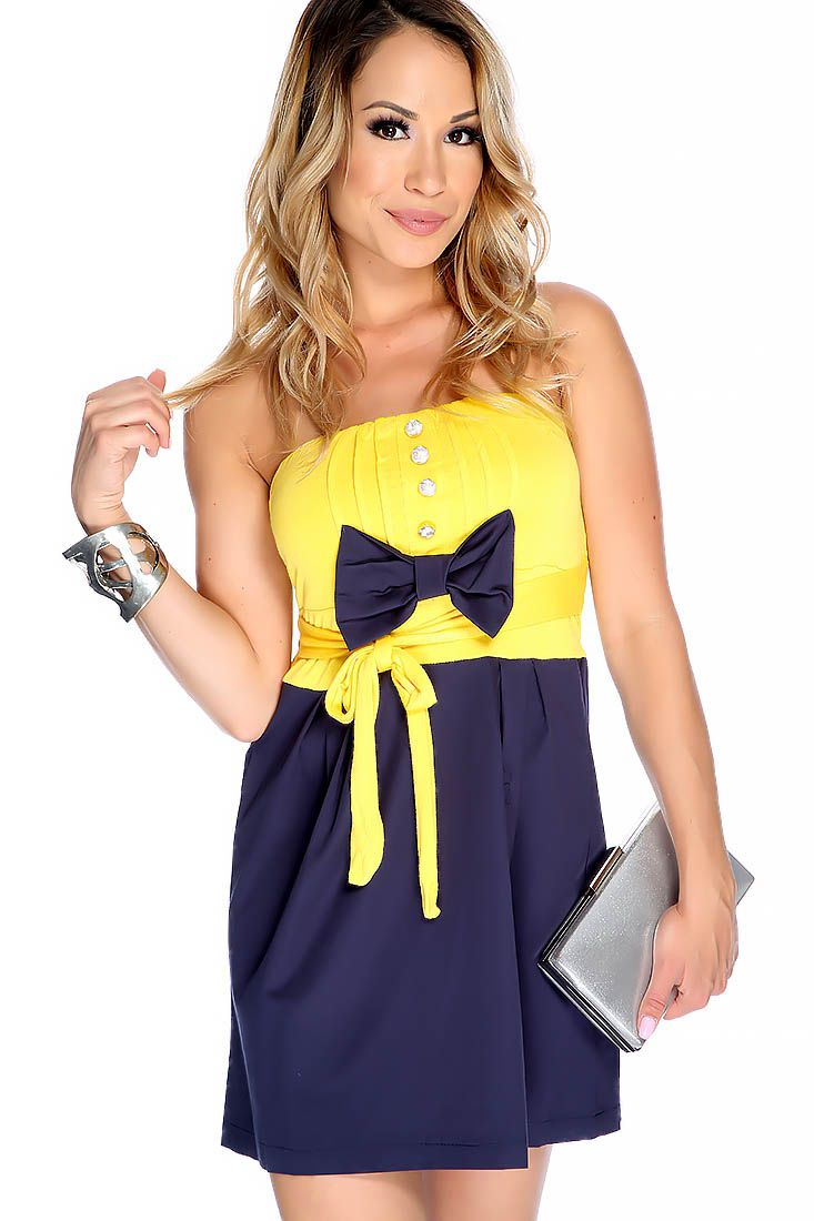 Get ready for summer with this sexy summer dress. This dress features a two tone color, bow accent, high polished accent, strapless, and to finish off with a flowy fit.