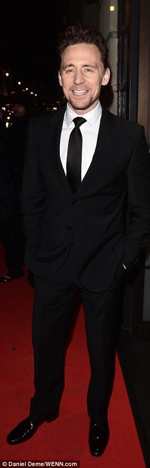 Dapper: Tom Hiddleston hit up the bash looking dapper in a dark suit...