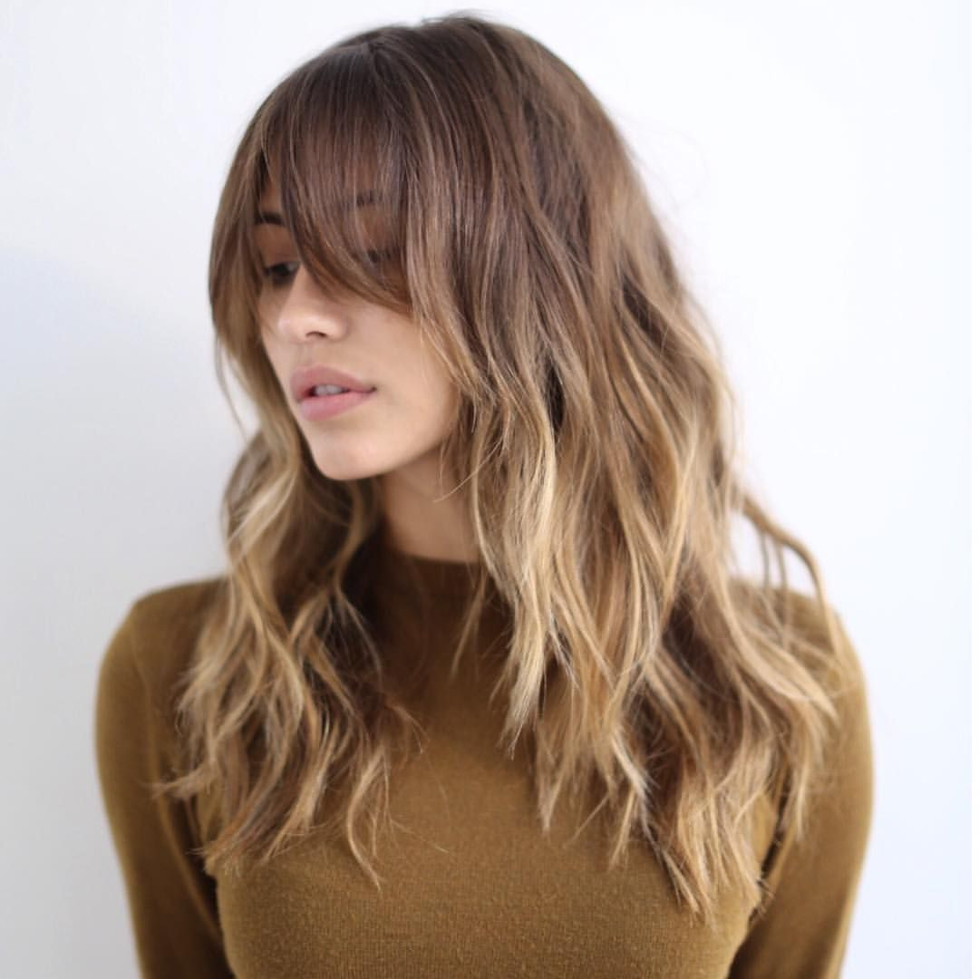 12 Hairstyles That Will Make You Want Bangs Again