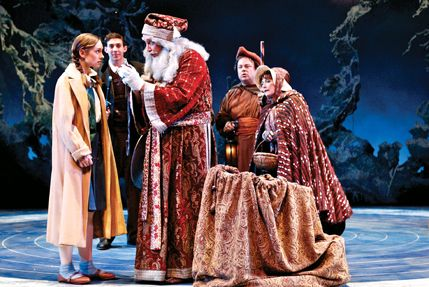 Father Christmas gives Lucy a gift, as Peter and Mr. and Mrs. Beaver look on | Lion witch ...