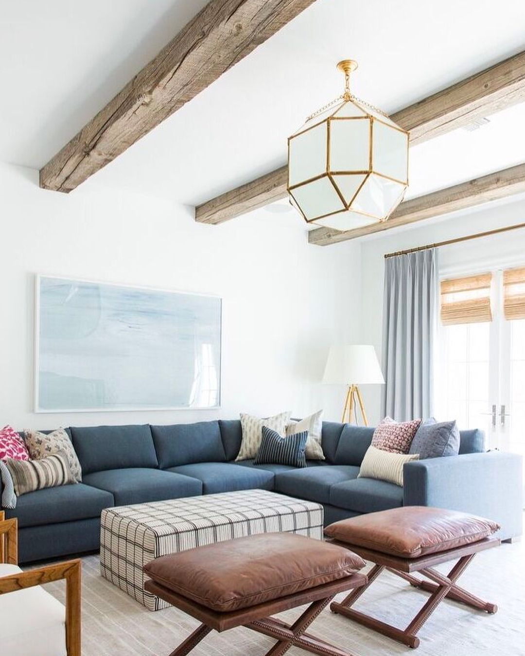 Living Room with Blue Couch and Geometric Light Fixture - pinned by ...
