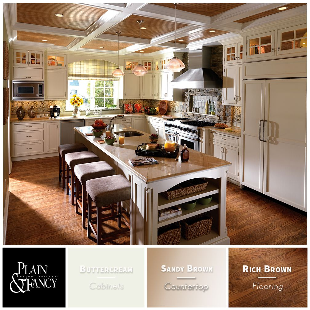 This Transitional Kitchen Mixes Rich Wood Tones And Classic Buttercream Finished Kitchen Cabinets For A Plea Kitchen Redo Kitchen Colors Kitchen Craft Cabinets