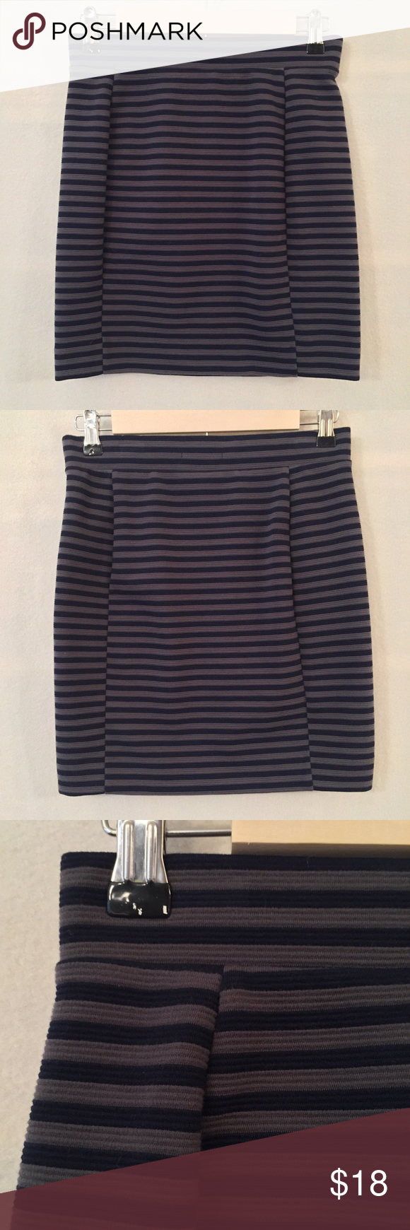 """Madewell grey & navy blue Striped mini skirt EUC. No stains or holes. Madewell """"Ridgestripe"""" navy blue and grey striped mini skirt. Strategically placed side panels. Short, straight mini skirt. Unlined. Pull on style. 67% polyester, 32% cotton, 1% spandex, textured and a hint of stretch. Measurements (flat): waist 13"""", hip 16"""", length 17"""". Style 05117. Machine wash. No trades. Madewell Skirts Mini"""