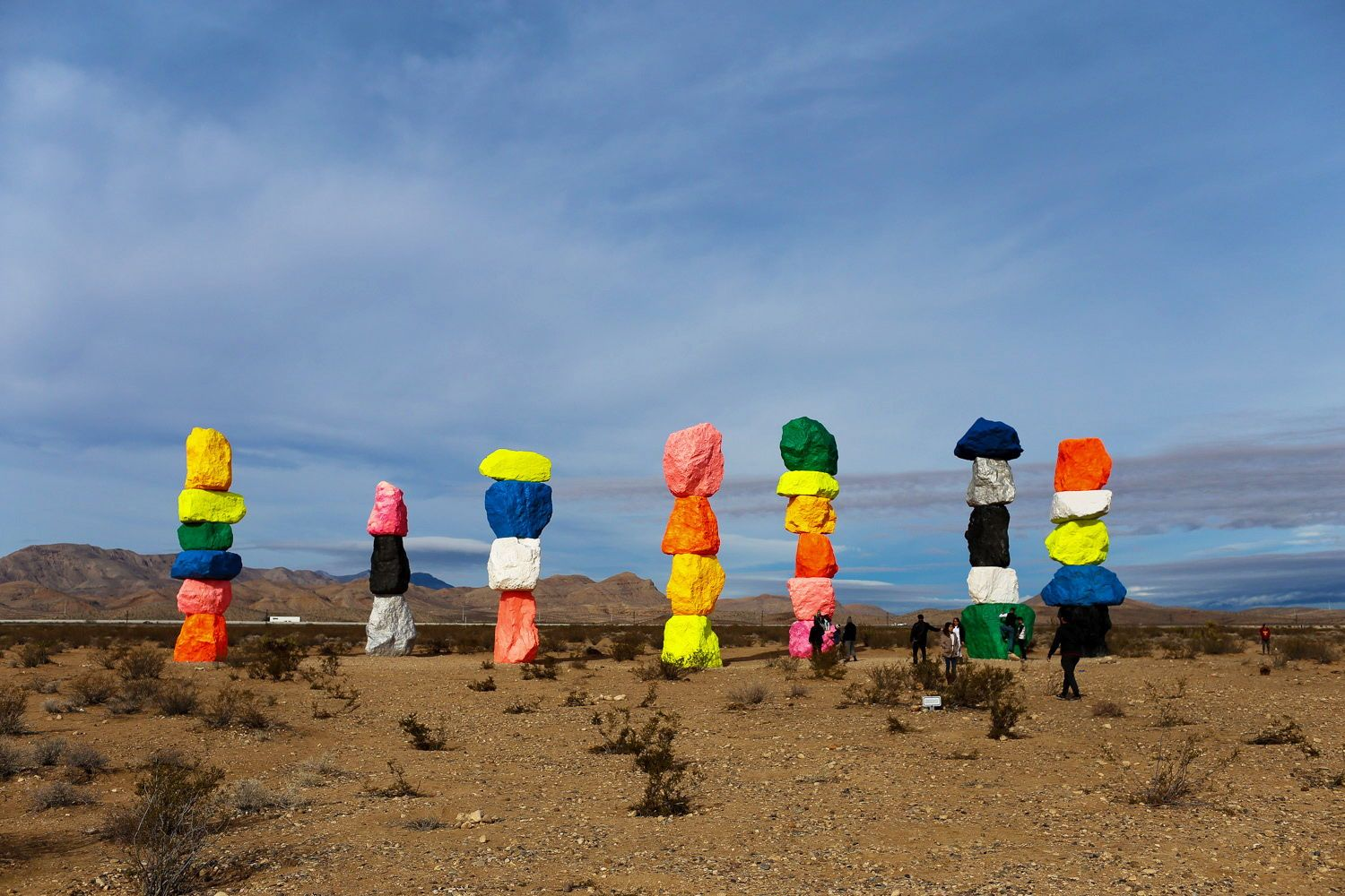 Visit The Coolest Desert Art Installation You Can Find Seven Magic Mountains Is Located In The Nevada Desert Outsi Seven Magic Mountains Desert Art Vegas Trip