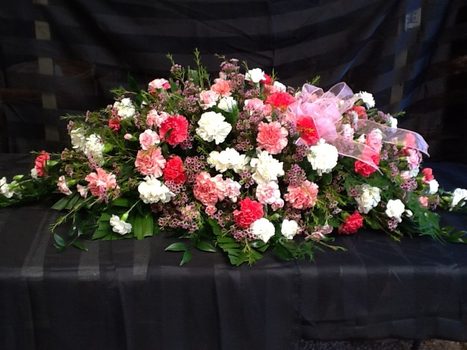Pink And White Carnation Casket Spray Bunga