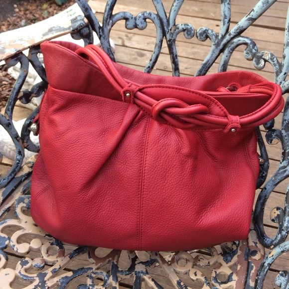 Allison Scott Fire Engine Red Leather Knotted Bag Beautiful red all leather handbag by Allison Scott. Red and White toile lining with loads of pockets.  Cool knot top handle. Allison Scott Bags