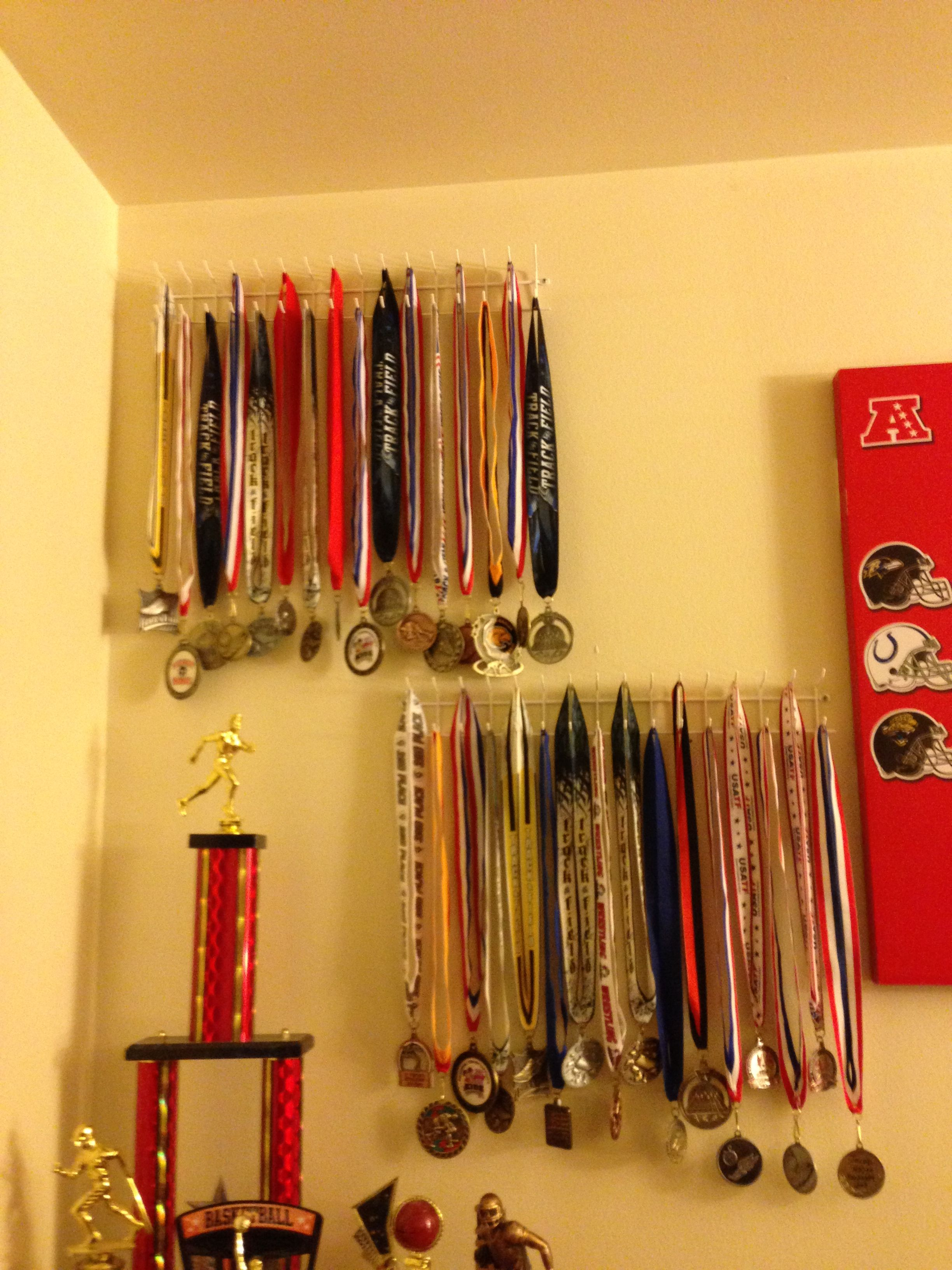 Easy and cheap way to display medals. Elfa hook tie &belt rack found ...