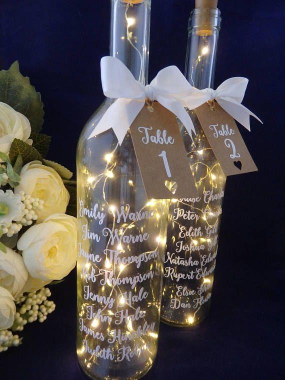 Diseño de la mesa de la boda, diseño de la mesa de la botella, números de placa de la boda, luz central