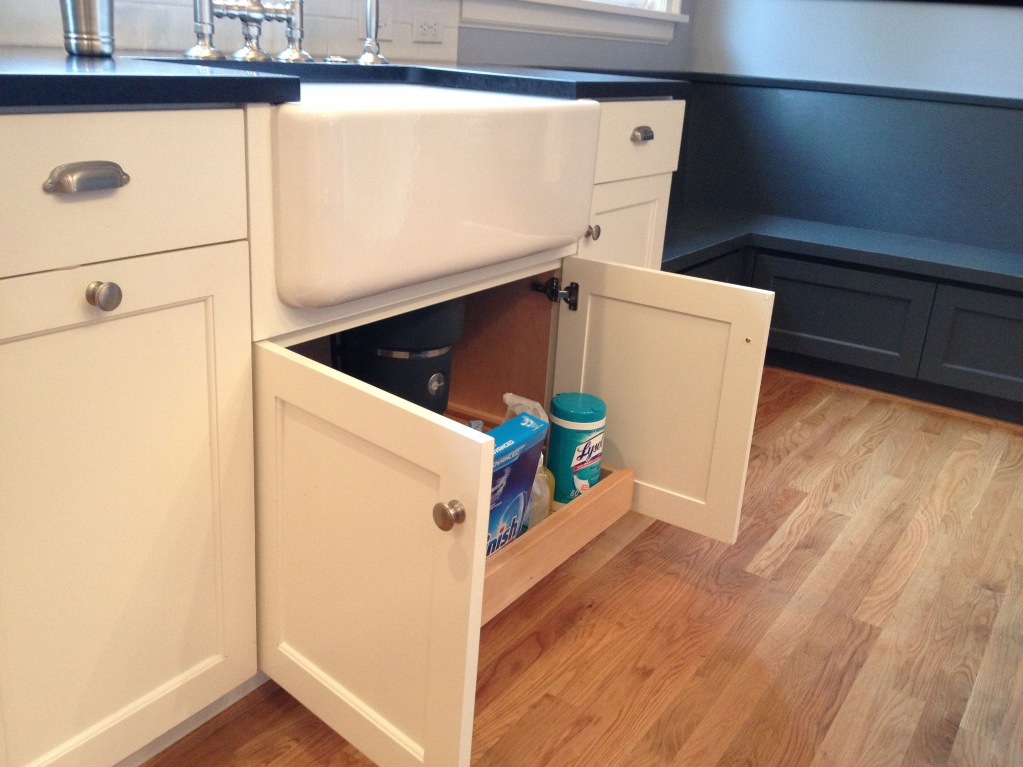 Custom white cabinets with farmhouse sink Pull-out under ...