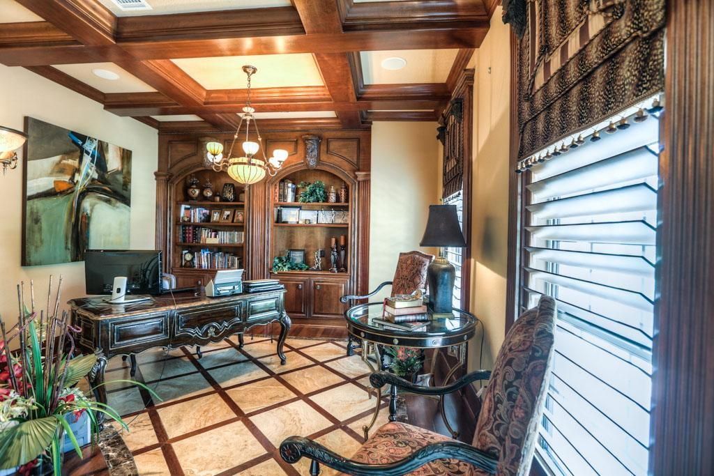 The luxurious study with built in shelving and custom