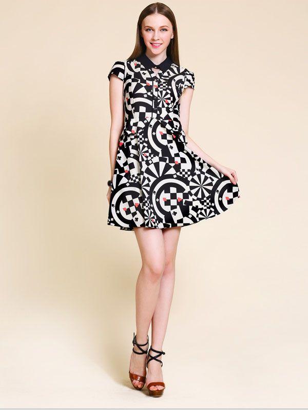 03dffc37f666 Retro black white print short-sleeved lapel dress. Black collar frames face  and calms the wild pattern