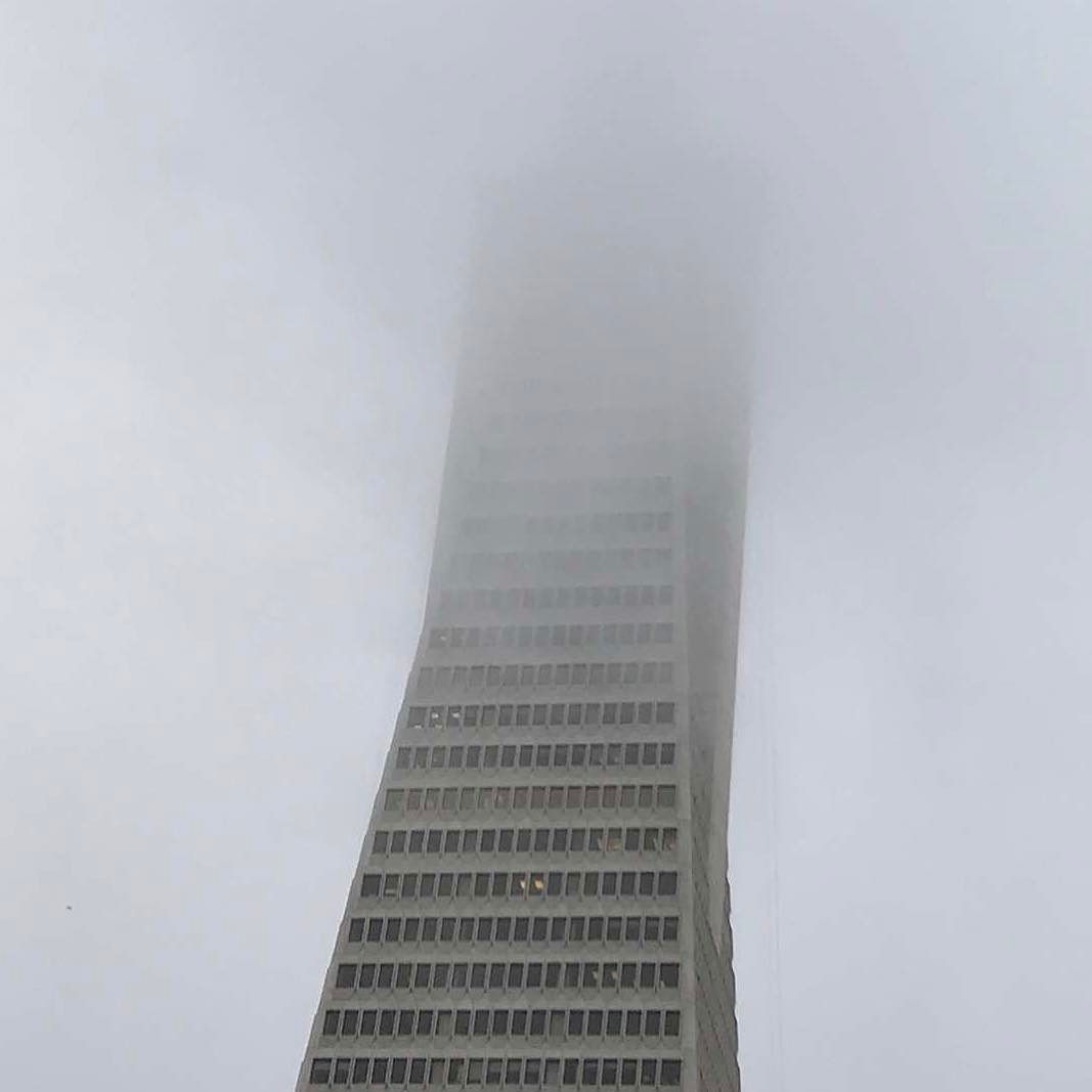 Transamerica Pyramid disappearing into @karlthefog tonight. From the city that has #StarFleetAcademy...  It was so hot the last few days and even this morning and now boom back to fog and chilly wind. I love it.  #sanfranciscobayarea #sanfrancisco #fog #weather #instagood #instapic #sky #perspective #architecture #clouds #maythe4thbewithyou