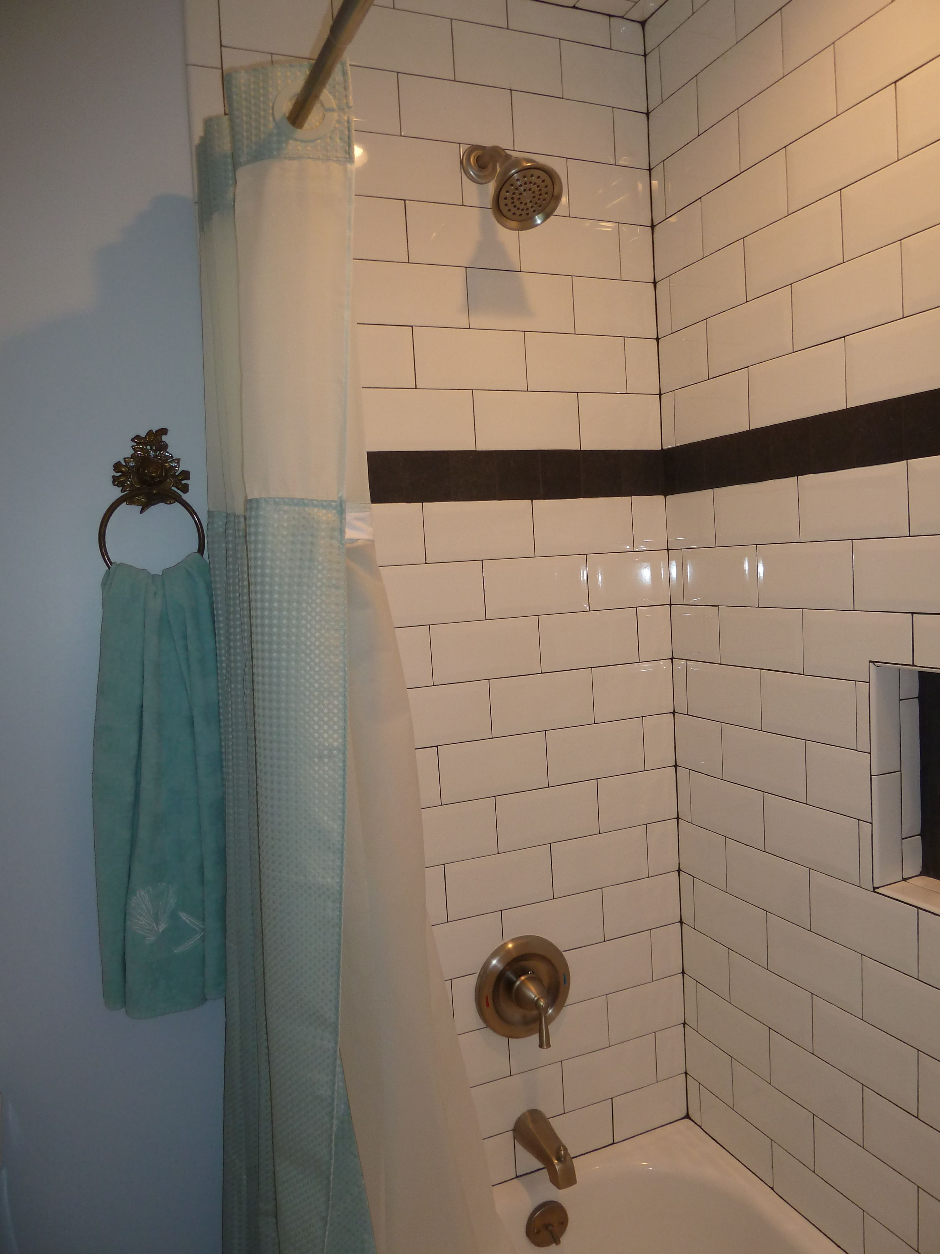 Beveled edge large white subway tile black grout and flat finish